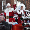 BRYAN EATON/Staff photo. Santa and Mrs. Claus greet attendees at the Amesbury Santa Parade and Christmas Tree lighting on Saturday.