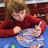 BRYAN EATON/Staff photo. Rosie Barbour, 4, of Rowley works on her collage of Nemo and his friends in the bottom of the ocean. She was at the crafting event at the Newburypor Public Library Children's Room for school vacation.