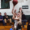 BRYAN EATON/Staff photo. Pentucket's Kenny Lee tries for two as Manchester-Essex defender John Shaw covers.