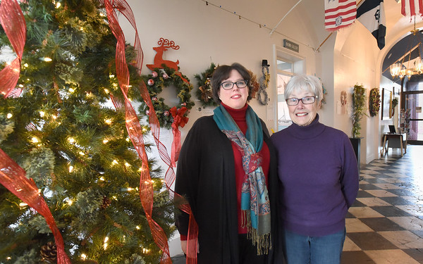 BRYAN EATON/Staff photo. Kristin Hunter, left, Custom House Maritime Museum Holiday House Tour co-chairman and Mary Beth Pelletier, who runs the museum store.
