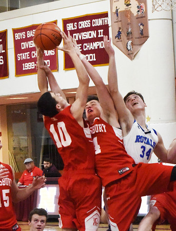 BRYAN EATON/Staff photo. Amesbury's Ethan Catania and Logan Burrill go for the ball with Georgetown's Hunter Lane.