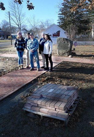 JIM VAIKNORAS/Staff photo Kimberly Turner, Chair of the Newburyport Parks Commission, Mike Hennessey, Parks Manager, Brad Kutcher, Owner, Bradku Construction, Kevin Hunt, Veterans Services Director and Parks Director Lisë Reid pose for a photo at Cornelius Doyle Triangle in Newburyport Friday. Kutcher donated the brick walkway.
