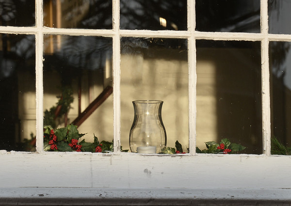 BRYAN EATON/Staff photo. Another Christmas decoration in another window at the Old South Church.