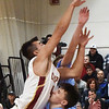 BRYAN EATON/Staff photo. Newburyport's Parker McLaren shoots over Mason Ferrick.