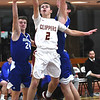 JIM VAIKNORAS/Staff photo Newburyport's Max Gagnon drives past Georgtown's #24, Brendan Willis and #3 Mike Lunquist at the Rowinski Holiday Tournament championship game at Newburyport High School Friday night.