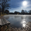 BRYAN EATON/Staff photo. Morning sunlight reflects off the ice on the Frog Pond at the Bartlet Mall in Newburyport on Thursday morning, though it's too thin to walk on. The temperature barely gets above freezing during the weekend and during the first part of next week.