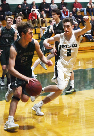 BRYAN EATON/Staff photo. Dylan Wilson looks for a way past Pentucket's Ryan Gallagher.