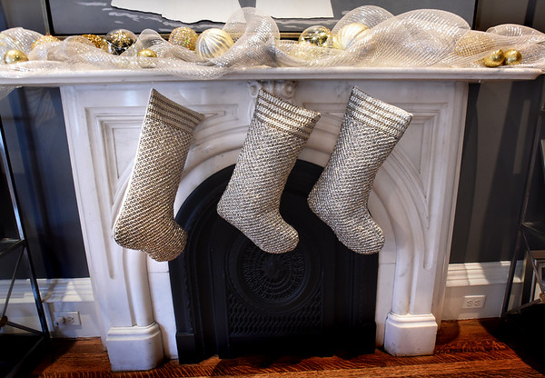 BRYAN EATON/Staff photo. Silver stockings on the mantle of the Geerlings home.