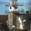 BRYAN EATON/Staff photo. Workers had nice weather Monday working on top of St. Pauls Church in Newburyport in a view over the water fountain in the Frog Pond at the Bartlet Mall. They have been doing needed repairs on the bell tower over the past couple months on the structure which was built in 1922 of Rockport Granite to replace a wooden structure that was constructed in 1800 and burned in 1920.