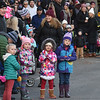 BRYAN EATON/Staff photo. Youngsters look up Main Street in Amesbury looking for Santa Claus's arrival.