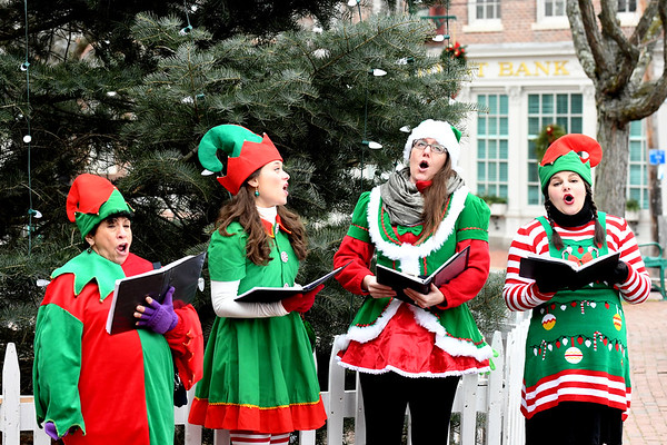 JIM VAIKNORAS/Staff photo The Off the Shelf Carolers, Cyndi Geller,Melanie Colby, Kirstin Olson, and  Luara Smith, spread joy through out Market Square at Amesbury's Winterfest Sunday afternoon.