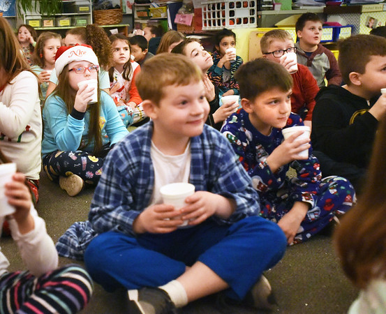 BRYAN EATON/Staff photo. Third-graders met in LIsa Bissell's class got in their pajamas to watch The Polar Express on Thursday. The second group got to enjoy hot chocolate and popcorn in what has become a tradition at the school.
