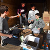 BRYAN EATON/Staff photo. Newburyport Police and Fire Departments held their food drives on at Shaw's and Market Basket on Saturday. Sorting food donations for the police department's Fill-a-Cruiser at Shaw's are Newburyport High School students working on their community service committments are, from left, Ethan Duggan, 14, Max Ligols, 15, Nick Daly, 15, and Calvin Murray, 14.
