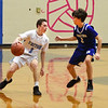 BRYAN EATON/Staff photo. Triton's TJ Overbaugh looks to get around Arlen Winer.