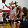 JIM VAIKNORAS/Staff photo Amesbury's Aillison Napoli powers her way for 2 against Hamilton-Wenham Friday night at Amesbury.