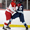JIM VAIKNORAS/Staff photo Triton's Brad Lindholm checks Melrose's Andrew Calvert at Kasabuski Rink in Saugus.