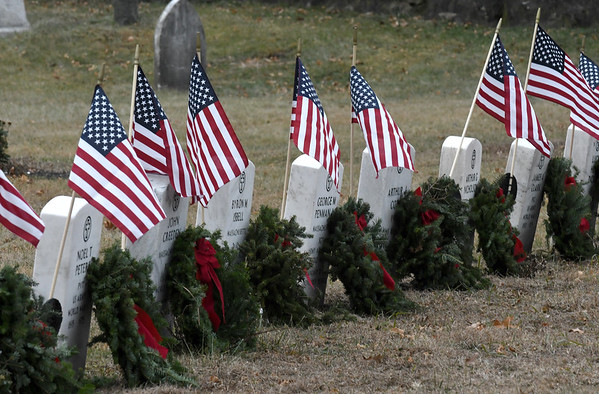 JIM VAIKNORAS/Staff photo Wreaths courtesy of Wreaths Across America, laid down of Saturday, decorate the graves of veterans at Veterans Cemetery in Newburyport.