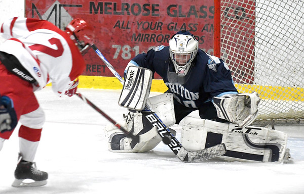 JIM VAIKNORAS/Staff photo Triton goalie Ben Fougere makes a save against Melrose's Quinn McCarthy at Kasabuski Rink in Saugus.