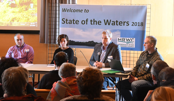 """JIM VAIKNORAS/Staff photo EPA representatives Todd Burci, Alexandra Dichter, Sean Dixon and Ted Lavery host a panel at """"State of the Waters"""" at the Parker River Wildlife Refuse headquarters Friday."""