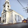 BRYAN EATON/Staff photo. Newburyport firefighters acted quickly to put out a fire on a window sill at the Old South Church apparently caused by a candle in part of a Christmas decoration.