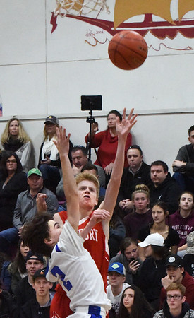 BRYAN EATON/Staff photo. Amesbury's Cam Kelleher goes for two over Georgetown's Arlen Winer.