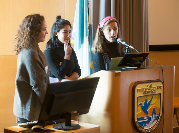 """JIM VAIKNORAS/Staff photo Members of the Climate Cafe program, Bailey Fogel of Newburyport High School, Tessa Devoe of Ipswich High School and Jeadin Guldenstern of Newburyport High School speak at """"State of the Waters"""" at the Parker River Wildlife Refuse headquarters Friday."""