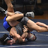 JIM VAIKNORAS/Staff photo Triton's Zander Rolf wrestles Tre Aulson in the 120lb weight class at Triton Wednesday.
