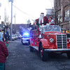 Amesbury: Santa waves as he makes his way down Main Street in the Amesbury Santa Parade Saturday. Jim Vaiknoras/staff photo