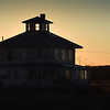 "BRYAN EATON/Staff photo. Thursday's sunset shines light through the cuppola of the ""pink house"" on the Plum Island Turnpike. The group Support the Pink House is trying to keep the building, which sits on land owned by the Parker River National Wildlife Refuge and is favorite subject of artists, could be demolished."