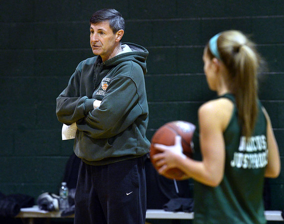CARL RUSSO/staff photo. John McNamara, Pentucket's head girls' basketball coach conducts practice with his team. 12/14/2017