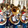 JIM VAIKNORAS/Staff photo Students in Santa hats play sousaphone with the Londonderry High School Band during the Merrimac Santa Parade Sunday in Merrimac.