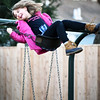 "BRYAN EATON/Staff photo. Regan Clyatt, 9, rides high on the swing at the playground at the Brown School on Monday afternoon. She and her fellow Brownies from Troop 89109 were waiting for their meeting to start inside for their ""cookie kickoff"" of planned Girl Scout Cookie sales."