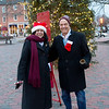 JIM VAIKNORAS/Staff photo Mayors Donna Holaday of Newburyport and Ken Grey of Amesbury ring the bell for the Salvation army in Market Square in Newburyport Friday afternoon. Grey was paying up on a wager they two had on the annual Thanksgiving football game, which Newburyport won.