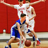 BRYAN EATON/Staff photo. Georgetown guard Brennan Troy moves past Nicholas Everett.