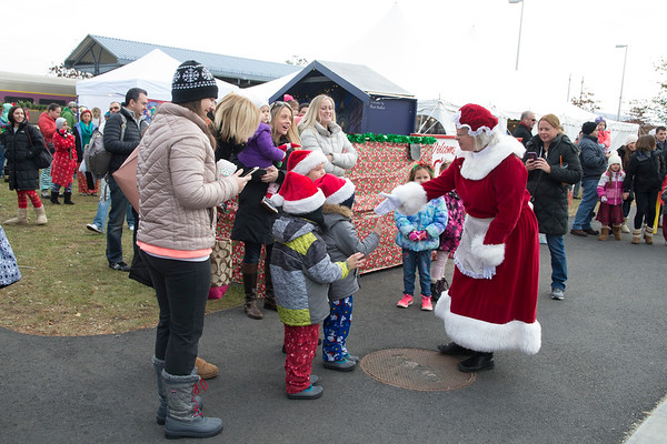 JIM VAIKNORAS/Staff photo Mrs.Claus greets people at the Polar Express at the MBTA station in Newburyport Saturday morning. Over 3500 passengers rode the train sponsored by the Immaculate Conception in it's 17th year.