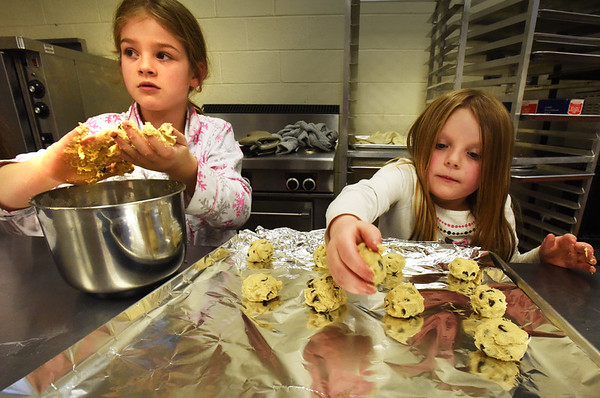 BRYAN EATON/Staff photo. It may be bitter cold outside, but in the kitchen at the Boys and Girls Club in Salisbury it's warm and aromatic as one of the activities is baking cookies every day this week. Mixing up a batch of chocolate chip cookies is Star Mispilkin, 8, left of Newburyport and Viveah Currier, 6, of Salisbury.