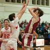 JIM VAIKNORAS/ Staff photo Newburyport's Noah Van Schalkwyk shoots over Amesbury's Nicholas Spanoghe during the finals of the Mike Rowinski Tournament at Amesbury High School Thursday night.