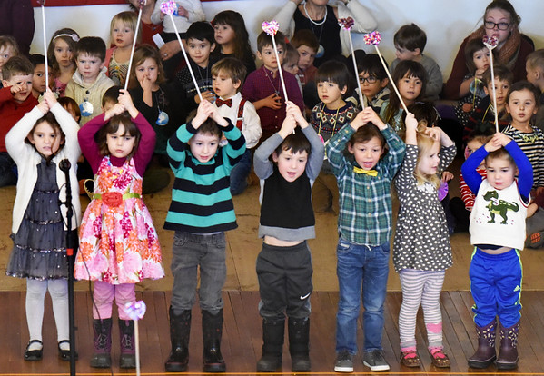 "BRYAN EATON/Staff photo. Youngsters sing ""Love Can Build a Bridge"" in the auditorium of Newburyport City Hall this week. They were at the Newburyport Montessori School' annual Peace Gathering."