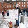 "BRYAN EATON/Staff photo. For eight years Sean O'Brien and his friends who graduated from Newburyport High School with him, rear, have been in a fantasy football leaque. Whoever comes in last, this year O'Brien, stands in Newburyport's Market Square on Christmas Eve day holding a self-depricating sign and has to stay until he gets 30 beeps from people driving by or for 30 minutes in this light-hearted ""tradition."""