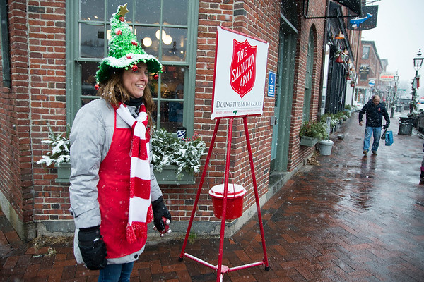 """And on every street corner you hear""<br /> JIM VAIKNORAS/Staff photo Melanie Johnson of Georgetown got dressed up to ring the bell in the snow on the corner of State and Liberty in Newburyport."