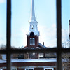 BRYAN EATON/Staff photo. The steeple of Newburyport's Central Congregational Church is framed by a window of the nearby Unitarian Church.