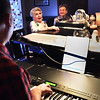 BRYAN EATON/Staff photo. Joan Boorhes, left, and Kathryn Burek sing some Christmas songs with Robert Dionne for the Countdown To Christmas piano cabaret on Monday. The two are residents of the Salisbury Assisted Living Center which has several musical events this week.