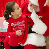 """ Jolly old Saint Nicholas lean your ear this way"" <br /> JIM VAIKNORAS/Staff photo Adison Moore, 6, has a chat with Santa at teh annual Newbury Elementary School"