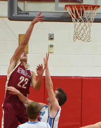 BRYAN EATON/Staff photo. Newburyport's Casey McLaren gets two points here.