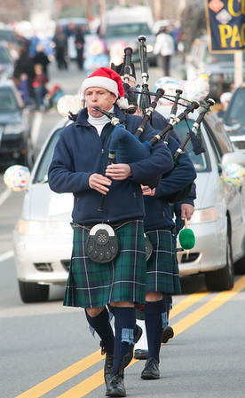 JIM VAIKNORAS/Staff photo A piper marches with the North Shore Pipers during the Merrimac Santa Parade Sunday in Merrimac.