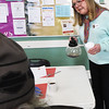 BRYAN EATON/Staff photo. Volunteer Pam Rankin offers someone some more coffee at St. Paul's Christmas breakfast.