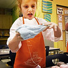 BRYAN EATON/Staff photo. Lia Garabino, 6, stretches out slime she made with friends in Robin O'Malley's first grade class at the Bresnahan School in Newburyport. Her family had the winning bid in the Newburyport Education Foundation to let her bring five friends to make the gooey concoction after school.
