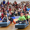 "BRYAN EATON/Staff photo. One team in the ""reindeer races"" at Salisbury Elementary School gets cheered on Friday afternoon. The races have become a popular tradition during the last day of school before Christmas vacation."