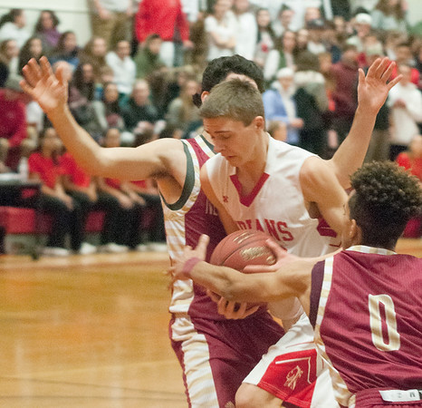 JIM VAIKNORAS/ Staff photo  Amesbury's William Sydlowski is fouled going to the basket against Newburyport during the finals of the Mike Rowinski Tournament at Amesbury High School Thursday night.