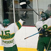 JIM VAIKNORAS/Staff photo Pentucket's #15 Liam McDonough, #8 Cameron Martin ans #7 Richie Hardy celebrate Hardy's first period goal against Lynnfield during their game at Veteran's Rink in Haverhill Wednesday night.